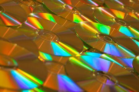 dvds: Golden Data CDs or DVDs Background Image.