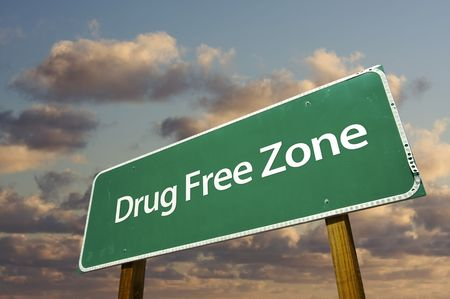 substance: Drug Free Zone Green Road Sign Over Dramatic Clouds and Sky.