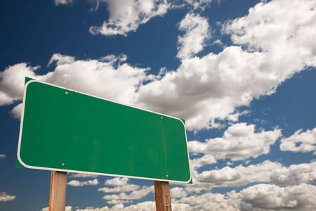 Blank Green Road Sign on Dramatic Blue Sky with Clouds - Plenty of Room For Your Own Text. photo