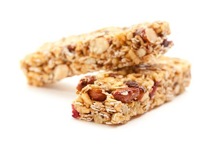 snack: Two Nutritious Granola Bars Isolated on White with narrow Depth of Field.