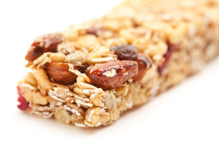 Granola Bar Isolated on a White Background with Narrow Depth of Field. photo