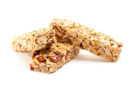 Two Nutritious Granola Bars Isolated on White with narrow Depth of Field.  photo