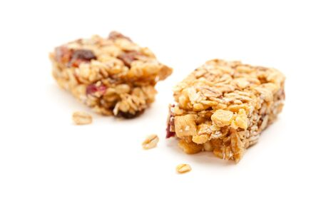 roughage: Broken Granola Bar Isolated on a White Background with Narrow Depth of Field.