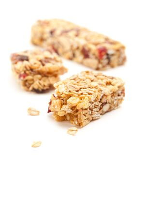 Broken Granola Bar Isolated on a White Background with Narrow Depth of Field. photo
