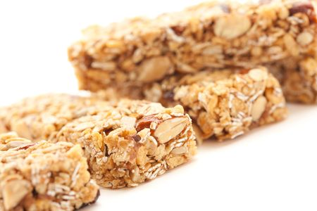 Several Granola Bars Isolated on a White Background with Narrow Depth of Field. photo