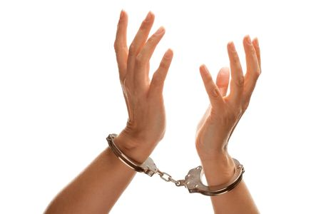 handcuffs female: Handcuffed Woman Desperately Raising Hands in Air Isolated on a White Background.