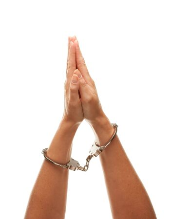 resisting arrest: Handcuffed Woman Desperately Raising Hands in Air Isolated on a White Background.