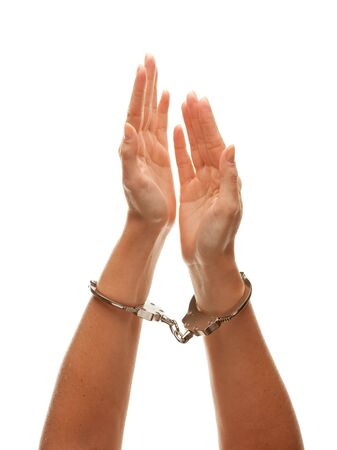 Handcuffed Woman Desperately Raising Hands in Air Isolated on a White Background. photo