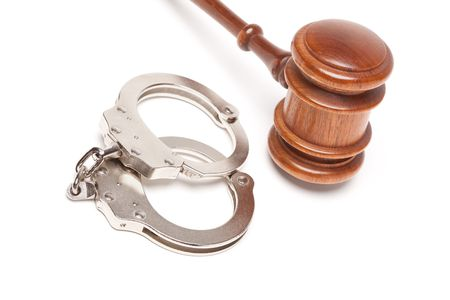 restraints: Gavel and Handcuffs Isolated on a White Background.