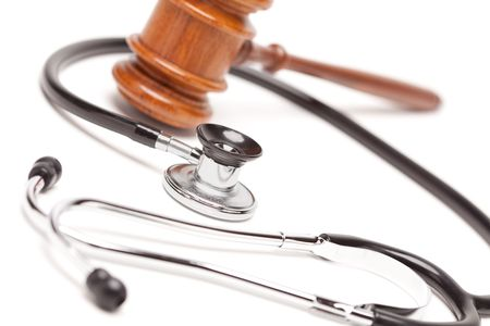 negligence: Black Stethoscope and Gavel Isolated on a White Background.
