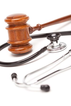 Black Stethoscope and Gavel Isolated on a White Background.