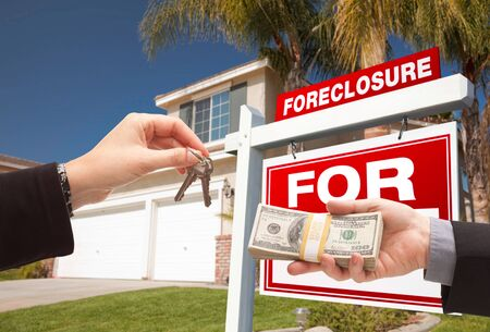 foreclosure: Handing Over Cash For House Keys in Front of House and Foreclosure Sign