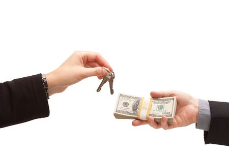 Handing Over Cash For Keys Isolated on a White Background. Stock Photo