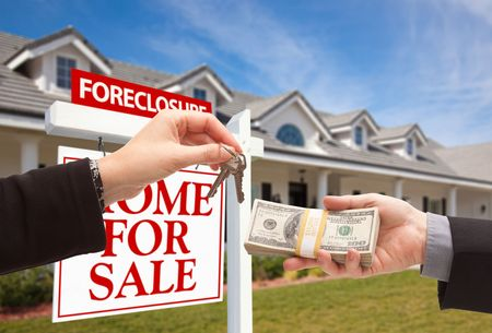 short sale: Handing Over Cash For House Keys in Front of House and Foreclosure Sign