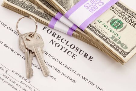 home sale: House Keys, Stack of Money and Foreclosure Notice - Cash for Keys Program. Stock Photo