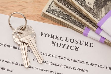 House Keys, Stack of Money and Foreclosure Notice - Cash for Keys Program. photo
