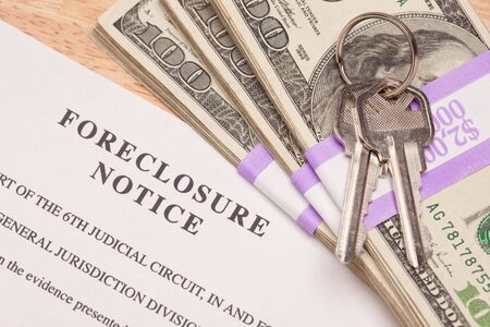 repossessing: House Keys, Stack of Money and Foreclosure Notice - Cash for Keys Program. Stock Photo