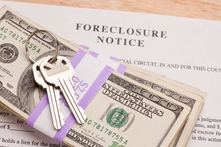 cash back: House Keys, Stack of Money and Foreclosure Notice - Cash for Keys Program. Stock Photo