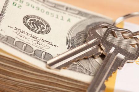 repossessing: House Keys on Stack of Money - Cash for Keys Program.