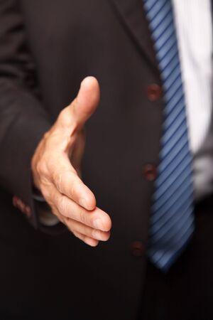 Businessman Reaching His Hand Out for a Handshake. Stock Photo - 6689511