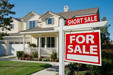 residential house: Short Sale Home For Sale Real Estate Sign and House - Right Side. Stock Photo