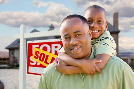 Happy African American Father and Son in Front of New Home and Real Estate Sign. Stock Photo - 6689558