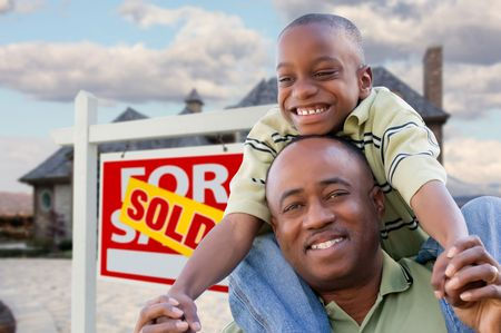 Happy African American Father and Son in Front of New Home and Real Estate Sign. Stock Photo - 6689555