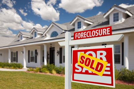 repossession: Sold Foreclosure Home For Sale Real Estate Sign in Front of New House -  Right Facing.