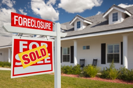 front facing: Sold Foreclosure Home For Sale Real Estate Sign in Front of New House - Left Facing. Stock Photo