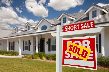 Sold Short Sale Home For Sale Real Estate Sign in Front of New House - Right Facing. Stock Photo - 6719112