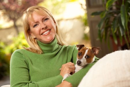 Woman and Jack Russell Terrier Puppy Enjoying a Day on The Sofa.