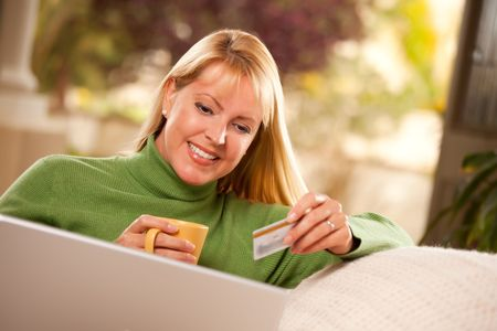 Beautiful Woman with Credit Card Using Her Laptop. photo