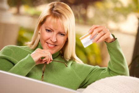 Beautiful Woman with Credit Card Using Her Laptop. Stock Photo - 6752012