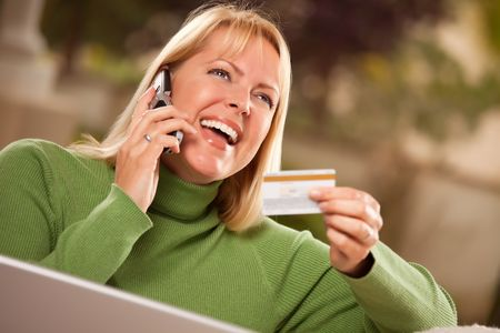Cheerful Woman on Her Phone and Laptop with Credit Card. Stock Photo - 6752016