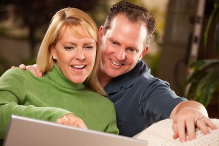 Handsome Happy Couple Using Their Laptop Together. photo