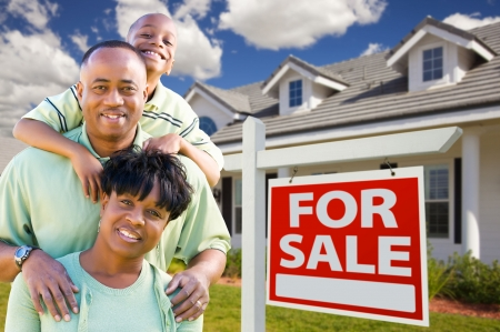 home sale: Happy and Attractive African American Family with For Sale Real Estate Sign and House. Stock Photo