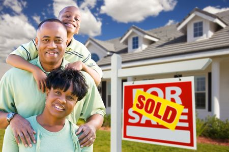 real estate sold: Happy and Attractive African American Family with Sold For Sale Real Estate Sign and House.