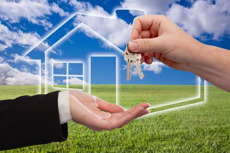 new contract: Handing Over Keys on Ghosted Home Icon, Grass Field, Clouds and Sky. Stock Photo