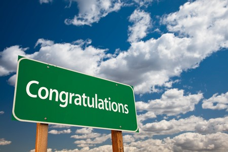 kudos: Congratulations Green Road Sign with Dramatic Clouds and Sky - The Kudos Sign Series.