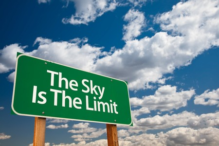 The Sky Is The Limit Green Road Sign with Dramatic Clouds and Sky. photo