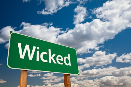kudos: Wicked Green Road Sign with Dramatic Clouds and Sky - The Kudos Sign Series.