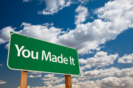 to acclaim: You Made It Green Road Sign with Dramatic Clouds and Sky - The Kudos Sign Series. Stock Photo