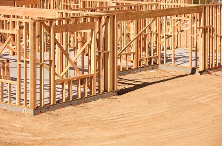 rafters: New Residential Home Construction Framing Site Just Before the Roofing Phase.