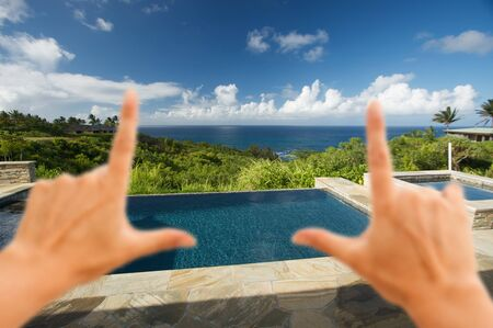 Hands Framing Pool and Hot Tub Overlooking the Ocean photo