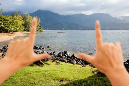 Hands Framing Beautiful Hanalei Bay Late One Summer Afternoon. photo