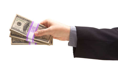 Man Handing Over Hundreds of Dollars Isolated on a White Background. photo