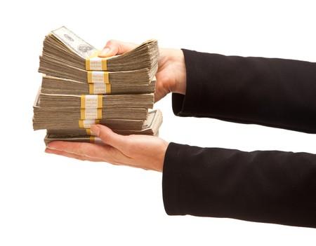 cash in hand: Mujer cuidado sobre cientos de d�lares aisladas sobre un fondo blanco.