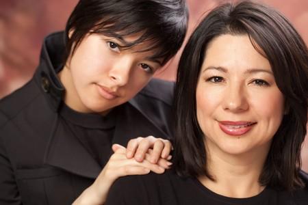 Attractive Multiethnic Mother and Daughters Studio Portrait. Stock Photo - 7029894