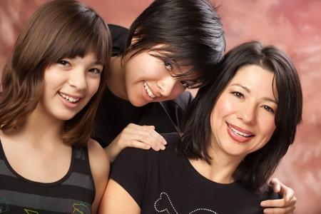 Attractive Multiethnic Mother and Daughters Studio Portrait. Stock Photo - 7039741