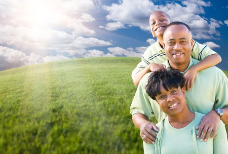 american children: Happy African American Family Over Clouds, Sky and Arched Horizon of Grass Field.
